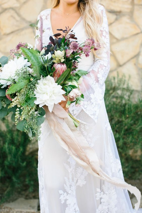 deep gem-tone palette and wildflowers and macrame wedding